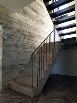 Concrete polished plaster, shuttered concrete effect textured plaster